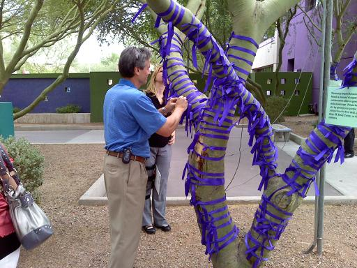 Ed Swift tying ribbon at Drowning Impact Awareness kickoff event